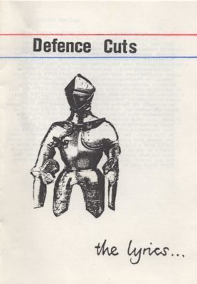 Lyric booklet designed by Colin Ward to accompany the cassette Defence Cuts by Daylight Dog (1990)